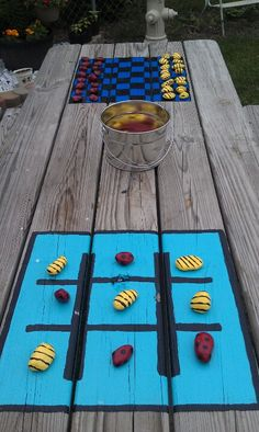 We have a small yard so utilizing space and making the most of what we have is the goal. Painted checker board and tic tac toe on picnic table. Painted rocks like lady bugs and bumblebees for pieces. Now 2 more games for kids to play outside. Painted Picnic Tables, Kids Picnic Table, Picnic Table Paint, Painted Game Table, Folding Picnic Table, Picnic Area, Backyard Games, Outdoor Games, Outdoor Camping