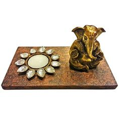 Lord Ganesha with Decorative T-Light Holder Rs 599/- http://www.tajonline.com/gifts-to-india/gifts-HBF21.html?aff=pint2014/