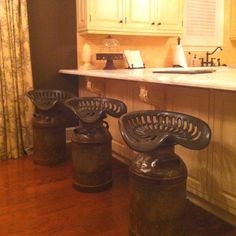 Milk can and tractor seat bar stools.