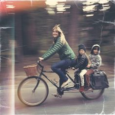 Mom & children on bicycle | via a well traveled woman