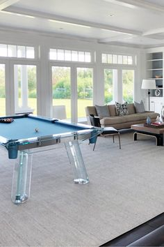 A sophisticated and modern game room design in the Hamptons featuring IMPATIA's luxury pool table Filotto.