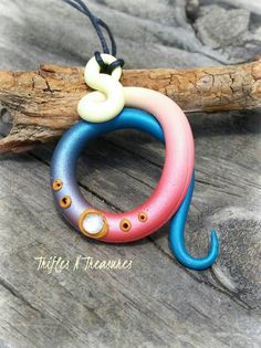 Hey, I found this really awesome Etsy listing at https://www.etsy.com/listing/292403055/bejeweled-twisted-tentacle-pendant