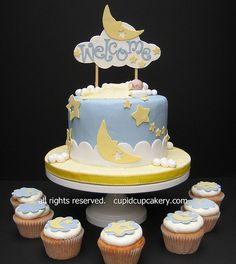 Moon and star cake and cupcakes.