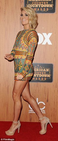 Carrie Underwood at The 3rd Annual American Country Countdown Awards held at The Forum in Inglewood, Calif (May 1, 2016) | Dress (Elie Madi), Jewelry (Anne Sisteron), Shoes (Jimmy Choo) Job done: Her final look of the night at the press room saw her in a coulour patterned minid dress which perfectly showcased her toned legs