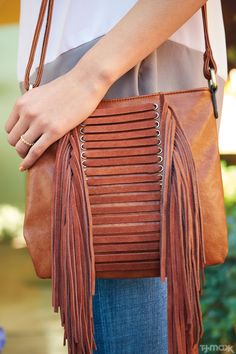T.J.Maxx truth: You can never have too many great handbags. This fringe cross-body style adds a boho touch to this silk blouse. It would also make the perfect music festival carryall paired with cut-offs and a peasant top.