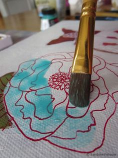 Once the ink has dried, you can paint a wash on top of the drawing.