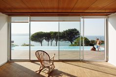 With its large openings, pool terrace and pine trees framing the picturesque bay beyond, this stunning coastal house in Spain channels the spirit of the Mediterranean Riviera quite beautifully. But don't be fooled: the house is in fact near the town of Perbes, in the northwest corner of the country, overlooking the much cooler Atlantic Ocean.