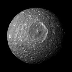 This mosaic, created from images taken by NASAs Cassini spacecraft during its closest flyby of Saturns moon Mimas, looks straight at the moons huge Herschel Crater and reveals new insights about the moons surface. Bright-walled craters, with floors and surroundings about 20 percent darker than the steep crater walls, are notable in this view.