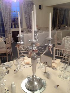 Plain candelabra wedding centrepiece dressed with pearls and ribbon email:info@brideslittlehelper.co.uk