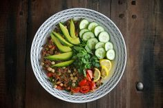 Quinoa Tabbouleh Salad -- so many layers of flavor here, from the quinoa toasted in coconut oil to the creamy avocado on top. For Phase 3, omit the pomegranate molasses.