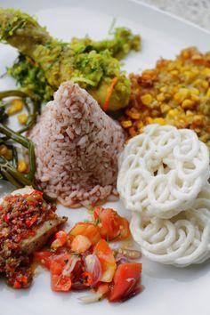 Nasi Manado, consist of Woku Balanga, Tuna Rica Rica, Perkedel Jagung, Tumis Kangkung, Sambal Dabu Dabu. Served immediately at Om Ham Resort & Spa Ubud
