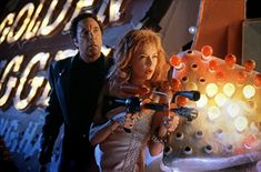 Annette Bening and Tom Jones in Mars Attacks! (1996)
