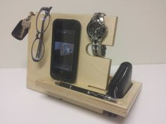 A phone dock gift to hold a phone, wallet, watch, keys, pen, glasses, etc. Easy assembly and great for travel. The Catchall™ is designed to provide a place for several items. It has slots for key chains, glasses, sunglasses, necklaces, bracelets, bluetooth headset, or headphones.