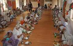 Vrindavan, India. Widows gather for ceremonial meal.