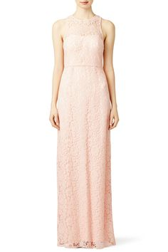 With an illusion neckline Slate & Willow's pink gown is charming for prom. We love it with a strand of pearls.