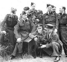 Wing Commander Guy Gibson (smoking his pipe), leader of the Dambusters raid, strokes his black Labrador 'Nigger' at RAF Scampton. In 1943 it was considered a perfectly acceptable name for a dog. Raf Bases, Lancaster Bomber, Black Labrador Retriever, Retriever Dog, Battle Of Britain, Guy, Royal Air Force, Second World, World History