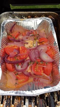Barbeque roasted salmon in tomato and lemonsauce with red onions and garlic