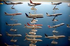 I have this above my bed. Dreamy. Quiet Planes - 20x200