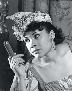KathKatherine Dunham Collection  Katherine Dunham in an undated photograph as Woman with a Cigar from Tropics.   Vintage African American photography courtesy of Black History Album, The Way We Were.erine Dunham Collection