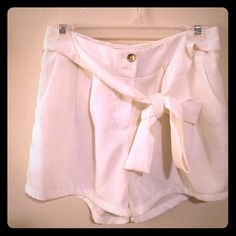 White shorts with bow tie Perfect summer shorts! Purchase from Mint Julep Boutique. Worn once. Shorts