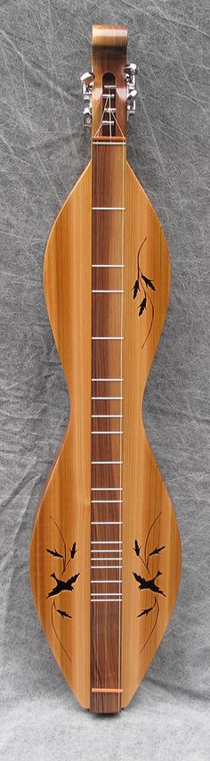Nicely figured Western Red Cedar soundboard on this Walnut Creek mountain dulcimer.
