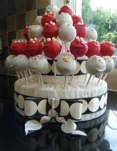 Red and white cake pops display tower
