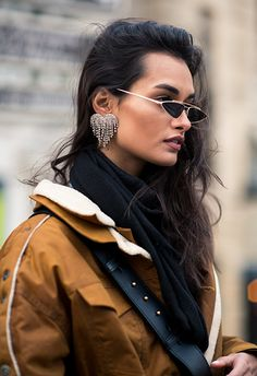Too long have accessories played second fiddle to your outfits — in Paris, the focus was on the plus-ones, with the general consensus being the bigger, the better. Jewelry was dripping with bling or embellishment, and when it came to sunglasses, angular and super-'80s shades added a jolt of fun to cold-weather looks.