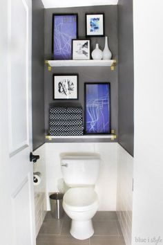 Water closets don't have to be boring. Take the focus off the toilet with tile, (faux) marble shelves, and art. This entire graphic glam bathroom makeover is a must see.