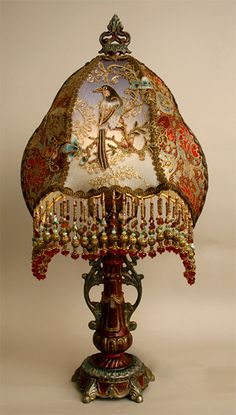 Ornate, petite hand painted antique table lamp holds an exotic Victorian bird lampshade with incredible silk Victorian ribbon side panels. T...