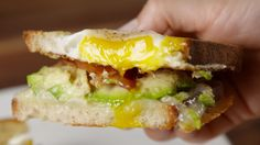 Egg in a Hole Breakfast Sandwich Seriously Ups The BEC Game  - Delish.com