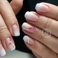 The Play of Studs on ombre Nails. Get your nails embellished with the ombre design along with the play of multi shades studs over them. This is amazing nail art design for spring, that can go with any of your outfit.