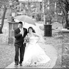 A rainy wedding day allows you to capture awesome pics.
