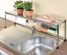 Get an over-the-sink shelf to double-up on counter space. apartment decorating 17 Ways To Squeeze A Little Extra Storage Out Of A Tiny Kitchen Sink Shelf, Apartment Storage, Apartment Kitchen, Apartment Inspiration, Apartment Decor, Small Spaces, Apartment Organization, Apartment Life, Small Apartments
