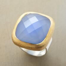 Glowing with lovely color, this unique blue chalcedony ring lends a nearly regal sense of glamour.