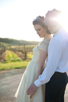 Vintage themed wedding shoot. Paige wore a delucate knee length wedding dress with short capped lace sleeves and a very fine birdcage veil.  Blog - Emma Sharkey Photography | Adelaide Wedding Photography