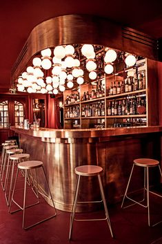 dreamy red and metallic bar at Hotel des Grands Boulevards, Paris