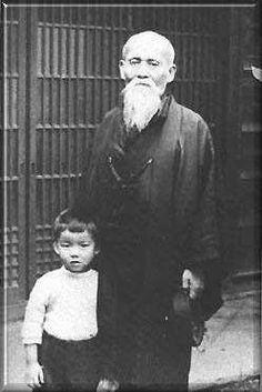 Morihei Ueshiba Sensei, founder of Aikido, with his grandson, Ueshiba Moriteru.