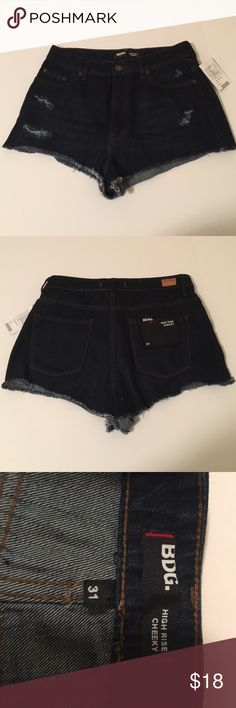 UO BDG High Rise Cheeky Denim Shorts, size 31 NWT UO High Rise Cheeky distressed shorts in dark wash denim, size 31. Rise is 12.5 and inseam is 1.5. Made from 100% cotton. Raw hem and all areas of distress done by the manufacturer. NWT, please ask if you have any questions. Urban Outfitters Shorts Jean Shorts