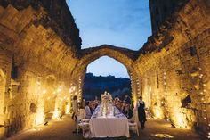 """The bride and groom wanted to have rich and detailed decoration to match the historical and important venue. The effect had to be vintage but elegant"", said Stefania, the wedding planner. The seated dinner was organized under an open air deconsecrated church, with a rustic top table and vintage fairy lights."