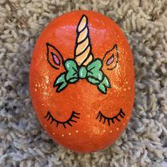 Orange unicorn face painted rock #rockpainting #paintedrock #bow