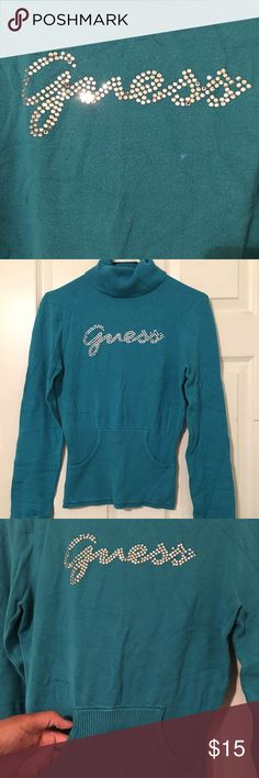 Teal blue turtleneck sweater with front pocket This sweater fits really cute! All of the rhinestones are still attached. Goes great with a pair of jeans and boots or heels Guess Sweaters Cowl & Turtlenecks