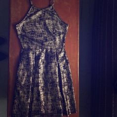 Metallic gold/black skater dress Super comfy and extremely flattering, this little number is perfect for parties year round :) Soprano Dresses Mini