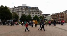 Birmingham citizens in Victoria Square enjoying the Big Hoot Owl trail.