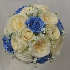 Blue silk roses, vintage peach blush roses, David Austin ivory roses, gyp flowers and diamante