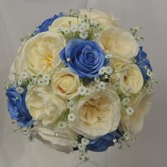 Blue silk roses, vintage peach blush roses, David Austin ivory roses, gyp flowers and diamante