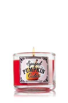 """Spiced Pumpkin Cider - Mini Candle - Bath & Body Works - Made using the highest concentration of fragrance oils and an exclusive blend of vegetable wax and lead-free wicks, our Mini Candles are contained in elegant glass and topped with a stamped-tin, flame-extinguishing lid. Mini Candle burns approximately 10-15 hours and measures 2"""" wide x 1 3/4"""" tall."""