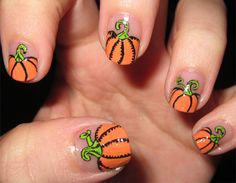 Pumpkins with sharpie detail...must try this on my daughter for Halloween!!!