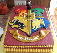 This Harry Potter sheet cake was for my nephew's 11th birthday.  Harry was made from gumpaste - he was the first figure I'd ever made.  The crest was made from marshmallow fondant.  I projected a picture of the crest I found on the internet on to the wall and traced the details on to wax paper, then transferred the wax paper stencils to the MMF to cut.  Buttercream frosting smoothed with Via.  Viva Viva!!