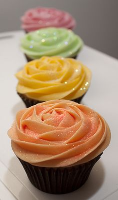 These cupcakes were made for a birthday party and the brief was simply vanilla sponge and icing with pastel colours. It's difficult to see in the photo, but the peach colour in real life is so beautiful, it looks like a real rose.