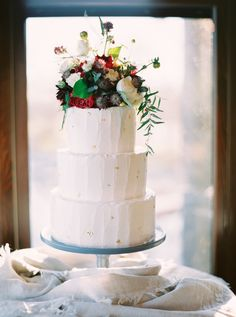 Textured buttercream wedding cake with edible gold foil detail from the Handmade Cake Company